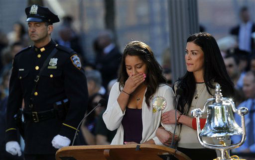 A woman becomes emotional after reading the name of her father as friends and relatives of the victims of 9&#47;11 gather for a ceremony marking the 11th anniversary of the attacks at the National September 11 Memorial at the World Trade Center site, Tuesday, Sept. 11, 2012, in New York. &#40;AP Photo&#47;Jason DeCrow&#41; <span class=meta>(AP Photo&#47; Jason DeCrow)</span>