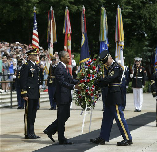 "<div class=""meta ""><span class=""caption-text "">President Barack Obama, center, participates in the wreathlaying ceremony at the Tomb of the Unknowns with Maj. Gen. Michael S. Linnington, left, Commander of the U.S. Army Military District of Washington, at Arlington National Cemetery on Memorial Day, May 27, 2013, in Arlington, Va. (AP Photo/Pablo Martinez Monsivais) (AP Photo/ Pablo Martinez Monsivais)</span></div>"