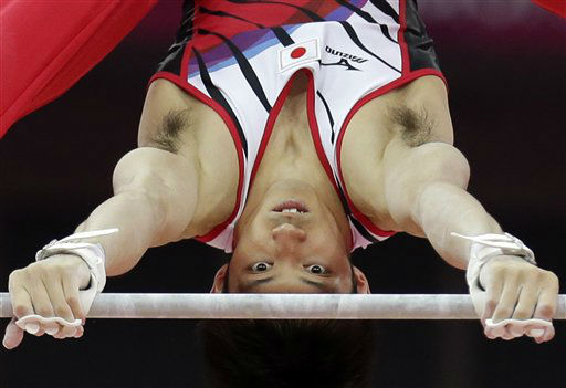 Japanese gymnast Kazuhito Tanaka performs on the horizontal bar during the artistic gymnastics men&#39;s individual all-around competition at the 2012 Summer Olympics, Wednesday, Aug. 1, 2012, in London. &#40;AP Photo&#47;Gregory Bull&#41; <span class=meta>(AP Photo&#47; Gregory Bull)</span>