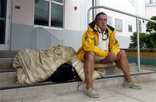 Dale Shelton waits to be taken to a shelter in Key West, Fla., Saturday, Aug. 25, 2012, as he prepares for the arrival of Tropical Storm Isaac, Saturday, Aug. 25, 2012. Isaac&#39;s winds are expected to be felt in the Florida Keys by sunrise Sunday morning. &#40;AP Photo&#47;Alan Diaz&#41; <span class=meta>(AP Photo&#47; Alan Diaz)</span>