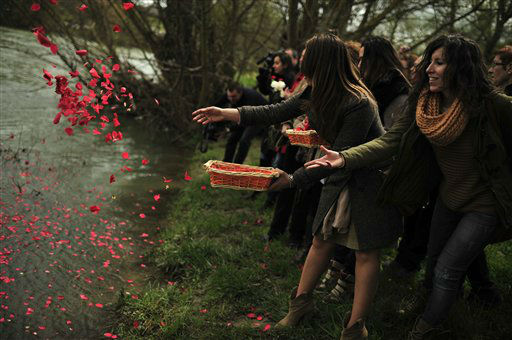 Female gypsy people throw flower petals into the Arga River in honor of their ancestors on the Day of the Gypsy, in Pamplona northern Spain, on Monday, April 8, 2013.&#40;AP Photo&#47;Alvaro Barrientos&#41; <span class=meta>(AP Photo&#47; Alvaro Barrientos)</span>