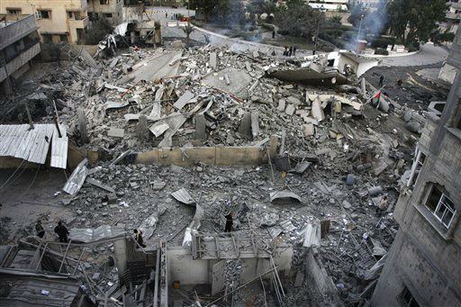 "<div class=""meta ""><span class=""caption-text "">Palestinians inspect the damage at the office building of Hamas Prime Minister Ismail Haniyeh after being destroyed during an Israeli airstrike in Gaza City, Saturday, Nov. 17, 2012. Israel bombarded the Hamas-ruled Gaza Strip with more than 180 airstrikes early Saturday, the military said, widening a blistering assault on militant operations to include the prime minister's headquarters, a police compound and a vast network of smuggling tunnels. The new attacks followed an unprecedented rocket strike aimed at the contested holy city of Jerusalem that raised the stakes in Israel's violent confrontation with Palestinian militants. (AP Photo/Majed Hamdan) (AP Photo/ Majed Hamdan)</span></div>"