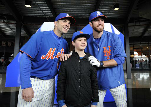 New York Mets&#39; David Wright, left, and Ike Davis pose for a photograph with Daniel Fusaro,12, of Staten Island, N.Y.,  before the Opening Day baseball game against the San Diego Padres at Citi Field in New York,  Monday, April 1, 2013. &#40;AP Photo&#47;Kathy Kmonicek&#41; <span class=meta>(AP Photo&#47; Kathy Kmonicek)</span>