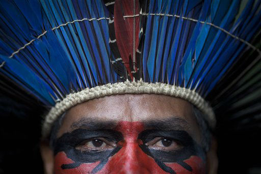 An indigenous man wearing face paint and a headdress stands inside the abandoned old Indian museum in Rio de Janeiro, Brazil, Thursday, March 21, 2013. Brazilian Federal Court ruled that indigenous people who have been occupying the building since 2006 have to leave the area because it is next to the Maracana stadium, which will be the site of the final match of the 2014 World Cup soccer tournament and the opening and closing ceremonies of the 2016 Olympic games. Authorities say the compound must go as the area around the stadium is being transformed into a shopping and sports entertainment hub. &#40;AP Photo&#47;Felipe Dana&#41; <span class=meta>(AP Photo&#47; Felipe Dana)</span>
