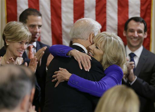 Vice President Joe Biden hugs his wife Jill Biden after taking the oath of office during and official ceremony at the Naval Observatory, Sunday, Jan. 20, 2013, in Washington. Vice President Biden was sworn in for a second term using the Biden Family Bible. &#40;AP Photo&#47;Carolyn Kaster&#41; <span class=meta>(AP Photo&#47; Carolyn Kaster)</span>