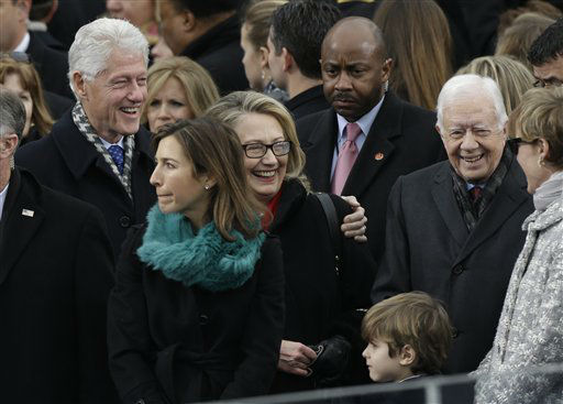 Secretary of State Hillary Clinton and former President Bill Clinton speak with former President Jimmy Carter at the ceremonial swearing-in for President Barack Obama at the U.S. Capitol during the 57th Presidential Inauguration in Washington, Monday, Jan. 21, 2013. &#40;AP Photo&#47;Pablo Martinez Monsivais&#41; <span class=meta>(AP Photo&#47; Pablo Martinez Monsivais)</span>