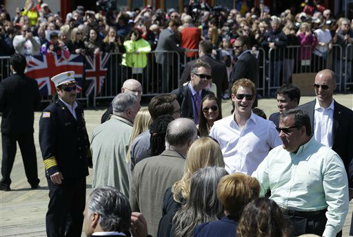 New Jersey Gov. Chris Christie, bottom right, talks to people as Britain&#39;s Prince  Harry, center right, stands behind him at Casino Pier during a tour of the area hit by Superstorm Sandy, Tuesday, May 14, 2013, in Seaside Heights, N.J. The prince toured the community&#39;s rebuilt boardwalk, which is about two-thirds complete. New Jersey sustained about &#36;37 billion worth of damage from the storm. &#40;AP Photo&#47;Julio Cortez&#41; <span class=meta>(AP Photo&#47; Julio Cortez)</span>