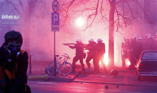 "<div class=""meta ""><span class=""caption-text "">Police try to secure the area during clashes at  the March of Independence  to mark Poland's Independence Day, in Warsaw, Poland, Sunday, Nov. 11, 2012. A  Police spokesman says that two officers have been injured in a brief clash with hooligans in which police fired rubber bullets and used tear gas during a right-wing march to mark Poland?s independence day. Earlier, thousands of people walked peacefully in another march, led by President Bronislaw Komorowski, and in smaller marches backed by various political options. Last year, many police officers were injured and there was damage in the streets when right-wing marchers clashed with opponents and police. (AP Photo/Czarek Sokolowski) (AP Photo/ Czarek Sokolowski)</span></div>"