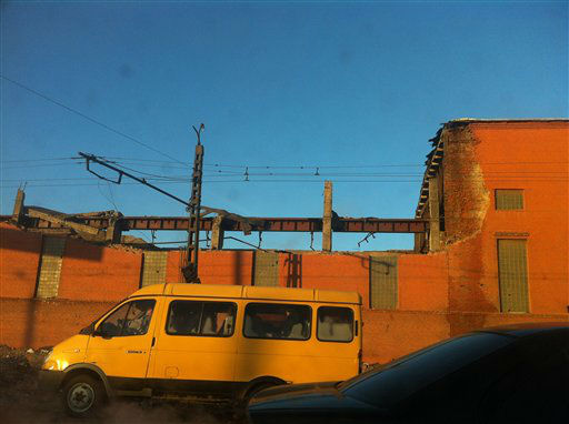 "<div class=""meta ""><span class=""caption-text "">In this photo taken with a mobile phone camera, a minivan passes a zinc factory building with about 600 square meters (6000 square feet) of a roof collapsed in Chelyabinsk on Friday, Feb. 15, 2013. A meteor streaked across the sky of Russia?s Ural Mountains on Friday morning, causing sharp explosions and reportedly injuring around 100 people, including many hurt by broken glass. (AP Photo/Valentin Kazakov) (AP Photo/ Valentin Kazakov)</span></div>"