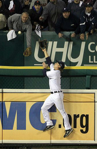 Detroit Tigers&#39; Andy Dirks tries to catch a home run by New York Yankees&#39; Eduardo Nunez in the ninth inning during Game 3 of the American League championship series Tuesday, Oct. 16, 2012, in Detroit. The Tigers won 2-1. &#40;AP Photo&#47;Carlos Osorio&#41; <span class=meta>(AP Photo&#47; Carlos Osorio)</span>