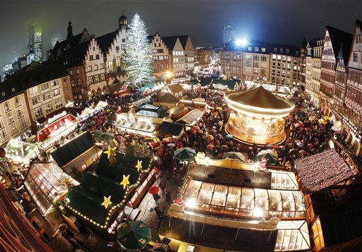 Hundreds of people gather in the rain to attend the opening of the traditional Christmas Market on the Roemerberg square in Frankfurt, Monday, Nov. 26, 2012. &#40;AP Photo&#47;Michael Probst&#41; <span class=meta>(AP Photo&#47; Michael Probst)</span>