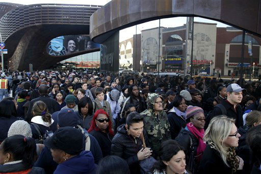 Commuters wait in a line to board buses into Manhattan in front of the Barclays Center in Brooklyn, New York, Thursday, Nov. 1, 2012. The line stretched twice around the arena and commuters reported wait times of one to three hours to get on a bus. &#40;AP Photo&#47;Seth Wenig&#41; <span class=meta>(AP Photo&#47; Seth Wenig)</span>