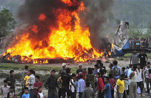 "<div class=""meta ""><span class=""caption-text "">Nepalese gather around the burning wreckage at the crash site of a Sita Air airplane near Katmandu, Nepal, early Friday, Sept. 28, 2012. A plane carrying trekkers to the Everest region crashed and burned just after takeoff Friday morning in Nepal?s capital, killing the 19 Nepali, British and Chinese people on board, authorities said. (AP Photo) (AP Photo/ Uncredited)</span></div>"