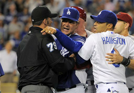 Los Angeles Dodgers manager Don Mattingly, center, yells at members of the Arizona Diamondbacks while umpire Manny Gonzalez holds him back as Jerry Hairston Jr. looks on after starting pitcher Zack Greinke was hit by a pitch during the seventh inning of their baseball game, Tuesday, June 11, 2013, in Los Angeles.  &#40;AP Photo&#47;Mark J. Terrill&#41; <span class=meta>(AP Photo&#47; Mark J. Terrill)</span>