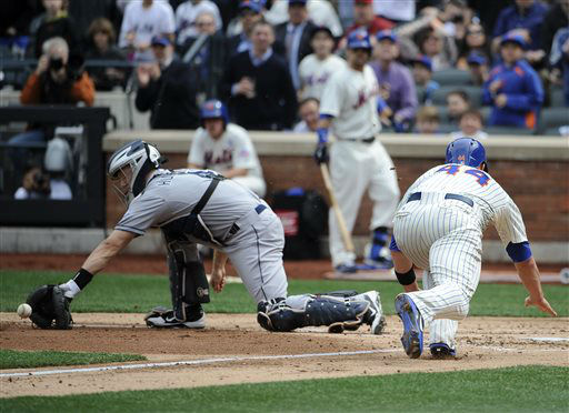 New York Mets&#39; John Buck &#40;44&#41; beats the throw to San Diego Padres catcher Nick Hundley &#40;4&#41; to score on a double by Reuben Tejada in the second inning on Opening Day of a baseball game at Citi Field on Monday, April 1, 2013 in New York. &#40;AP Photo&#47;Kathy Kmonicek&#41; <span class=meta>(AP Photo&#47; Kathy Kmonicek)</span>