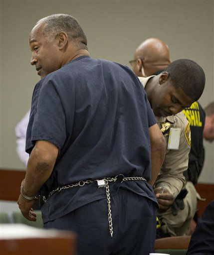 O.J. Simpson is handcuffed by Clark County corrections officer George Gafford after testifying during an evidentiary hearing in Clark County District Court, Wednesday, May 15, 2013 in Las Vegas. Simpson, who is currently serving a nine to 33-year sentence in state prison as a result of his October 2008 conviction for armed robbery and kidnapping charges, is using a writ of habeas corpus, to seek a new trial, claiming he had such bad representation that his conviction should be reversed. &#40;AP Photo&#47;Julie Jacobson, Pool&#41; <span class=meta>(AP Photo&#47; Julie Jacobson)</span>