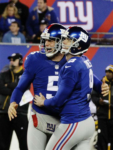 New York Giants&#39; Steve Weatherford &#40;5&#41; and Lawrence Tynes &#40;9&#41; celebrate a field goal by Tynes during the second half of an NFL football game against the Pittsburgh Steelers, Sunday, Nov. 4, 2012, in East Rutherford, N.J. &#40;AP Photo&#47;Bill Kostroun&#41; <span class=meta>(AP Photo&#47; Bill Kostroun)</span>