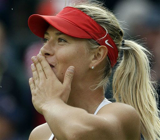 Maria Sharapova of Russia blows a kiss to the crowd after defeating Kim Clijsters of Belgium at the All England Lawn Tennis Club in Wimbledon, London at the 2012 Summer Olympics, Thursday, Aug. 2, 2012. &#40;AP Photo&#47;Elise Amendola&#41; <span class=meta>(AP Photo&#47; Elise Amendola)</span>