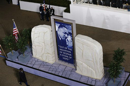"<div class=""meta ""><span class=""caption-text "">The Martin Luther King, Jr. Float moves down Pennsylvania Avenue en route to the White House, Monday, Jan. 21, 2013, in Washington. Thousands  marched during the 57th Presidential Inauguration parade after the ceremonial swearing-in of President Barack Obama. (AP Photo/Charlie Neibergall ) (AP Photo/ Charlie Neibergall)</span></div>"