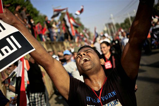 "<div class=""meta ""><span class=""caption-text "">An opponent of Egypt's Islamist President Mohammed Morsi chants slogans during a protest outside the presidential palace, in Cairo, Egypt, Wednesday, July 3, 2013. The deadline on the military's ultimatum to President Mohammed Morsi has expired, with 48 hours passing since the time it was issued. Giant cheering crowds of Morsi's opponents have been gathered in Cairo's Tahrir Square and other locations nationwide, waving flags furiously in expection that the military will act to remove the Islamist president after the deadline ends. (AP Photo/Khalil Hamra) (AP Photo/ Khalil Hamra)</span></div>"
