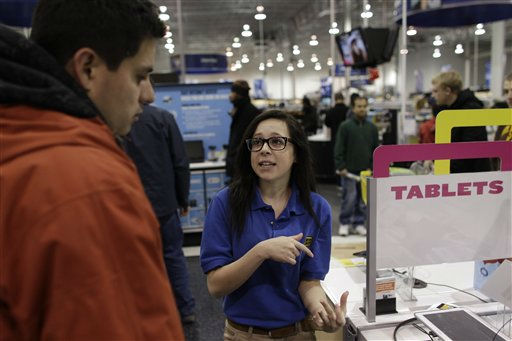 "<div class=""meta ""><span class=""caption-text "">Best Buy electronics store employee Maddy Cooke, a criminology major in college, helps a customer looking at computers, during a Black Friday sale that started at midnight, in Broomfield, Colo., early Friday Nov. 23, 2012. (AP Photo/Brennan Linsley) (AP Photo/ Brennan Linsley)</span></div>"