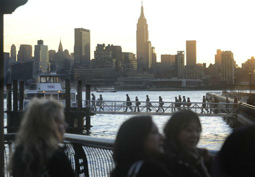 Commuters wait in a long line to board a New York Waterway ferry bound for midtown Manhattan at the 14th Street pier, Thursday morning, Nov. 1, 2012 in Hoboken, N.J.  Ferry service is running on a limited schedule in the wake of superstorm Sandy.  &#40;AP Photo&#47;Joe Epstein&#41; <span class=meta>(AP Photo&#47; Joe Epstein)</span>
