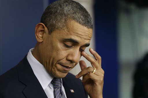 President Barack Obama wipes his eye as he speaks about the elementary school shooting in Newtown, Conn., Friday, Dec. 14, 2012, in the briefing room of the White House in Washington. &#40;AP Photo&#47;Charles Dharapak&#41; <span class=meta>(AP Photo&#47; Charles Dharapak)</span>