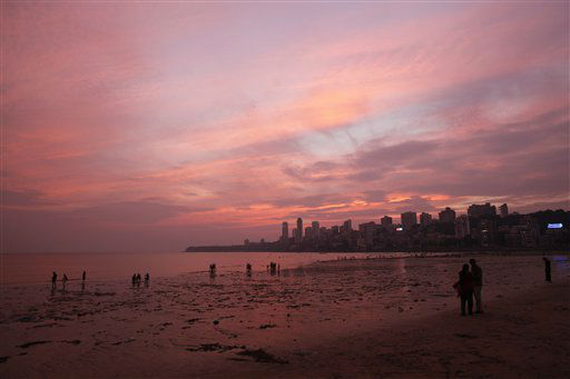 Indians stand on the Arabian Sea coast after sunset in Mumbai, India, Thursday, Nov. 1, 2012. &#40;AP Photo&#47;Rajesh Kumar Singh&#41; <span class=meta>(AP Photo&#47; Rajesh Kumar Singh)</span>