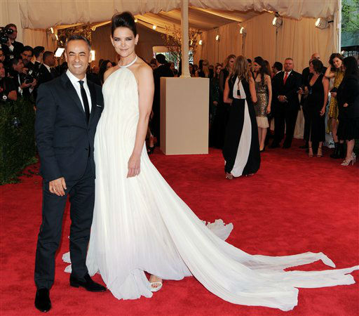 "<div class=""meta image-caption""><div class=""origin-logo origin-image ""><span></span></div><span class=""caption-text"">Designer Francisco Costa and actress Katie Holmes attend The Metropolitan Museum of Art Costume Institute gala benefit, ""Punk: Chaos to Couture"", on Monday, May 6, 2013 in New York. (Photo by Evan Agostini/Invision/AP)</span></div>"