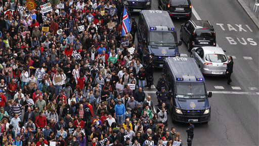 Protestors march to the parliament against austerity measures announced by the Spanish government, in Madrid, Spain, Tuesday, Sept. 25, 2012. Spain&#39;s Parliament has taken on the appearance of a heavily guarded fortress with dozens of police blocking access from every possible angle, hours ahead of a protest against the conservative government&#39;s handling of the economic crisis. The demonstration, organized behind the slogan &#39;Occupy Congress,&#39; is expected to draw thousands of people. It is due to start around 1730 GMT Tuesday. Madrid authorities said some 1,300 police would be deployed. The protestors call for Parliament to be dissolved and fresh elections held, claiming the government&#39;s austerity measures show the ruling Popular Party misled voters to get elected last November. &#40;AP Photo&#47;Andres Kudacki&#41; <span class=meta>(AP Photo&#47; Andres Kudacki)</span>