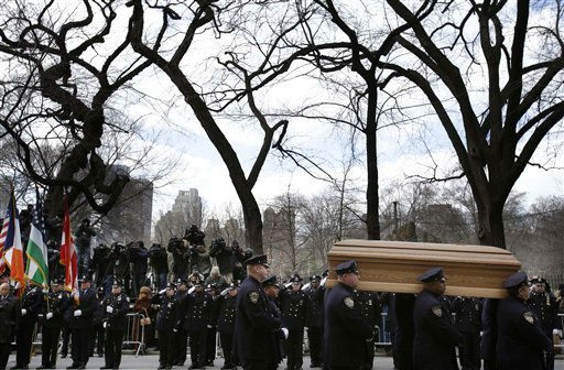"<div class=""meta image-caption""><div class=""origin-logo origin-image ""><span></span></div><span class=""caption-text"">A casket containing the body of former New York City Mayor Ed Koch is loaded into a hearse while city employees, politicians, media watch after his funeral in New York, Monday, Feb. 4, 2013. Koch was remembered as the quintessential New Yorker during a funeral that frequently elicited laughter, recalling his famous one-liners and amusing antics in the public eye. (AP Photo/Seth Wenig) (AP Photo/ Seth Wenig)</span></div>"