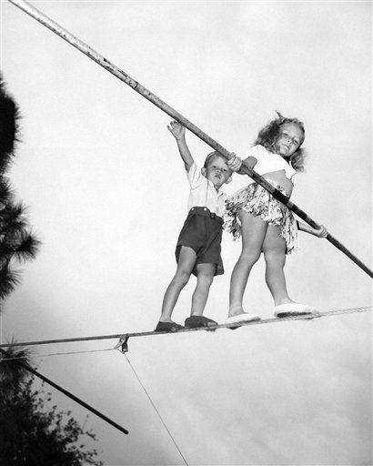 "<div class=""meta ""><span class=""caption-text "">Even the little Wallendas are nimble enough to walk along on high wires. Here at the winter quarters of the circus are Carla, nine years old, followed by little four-year-old Mario, Feb. 28, 1945. The children are here with their parents, members of the Wallenda troupe, high wire performers. (AP Photo) (AP Photo/ IP SK, SM. KEY A, PO. XMB)</span></div>"