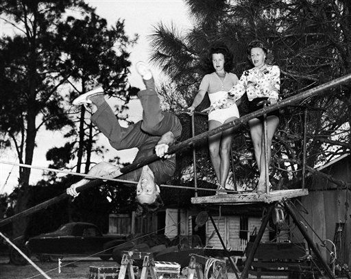 Herman Wallenda, a member of the Wallenda Troupe, high wire performers, perfects a roll-over act in Sarasota, Florida on Feb. 28, 1945 which nearly cost him his life at one of last year?s performances . Helen, right, and Henriette Wallenda watch. &#40;AP Photo&#41; <span class=meta>(AP Photo&#47; IP SM, NC. KEY V, N. XMEH)</span>
