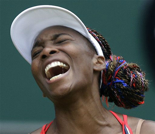 Venus Williams of the United States screams during her match against Aleksandra Wozniak of Canada at the All England Lawn Tennis Club in Wimbledon, London at the 2012 Summer Olympics, Tuesday, July 31, 2012. &#40;AP Photo&#47;Elise Amendola&#41; <span class=meta>(AP Photo&#47; Elise Amendola)</span>