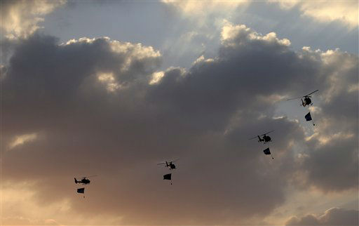 "<div class=""meta ""><span class=""caption-text "">Military helicopters fly over the presidential palace, in Cairo, Egypt, Monday, July 1, 2013. Egypt's military on Monday issued a 48-hour ultimatum to the Islamist president and his opponents to reach an agreement to ""meet the people's demands"" or it will intervene to put forward a political road map for the country and ensure it is carried out. (AP Photo/Hassan Ammar) (AP Photo/ Hassan Ammar)</span></div>"
