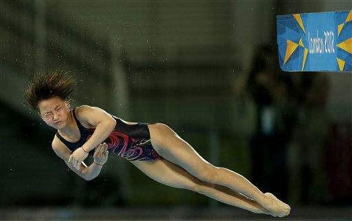 China&#39;s Hu Yadan competes in the women&#39;s 10-meter platform diving preliminaries at the Aquatics Centre in Olympic Park during the 2012 Summer Olympics Wednesday, Aug. 8, 2012, in London. &#40;AP Photo&#47;Charlie Riedel&#41; <span class=meta>(AP Photo&#47; Charlie Riedel)</span>