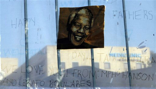A print of Nelson Mandela and get-well messages hanged outside of the Mediclinic Heart Hospital where former South African President Nelson Mandela is being treated in Pretoria, South Africa Monday, June 24, 2013. Mandela&#39;s health has deteriorated and he is now in critical condition, the South African government said. &#40;AP Photo&#47;Themba Hadebe&#41; <span class=meta>(AP Photo&#47; Themba Hadebe)</span>