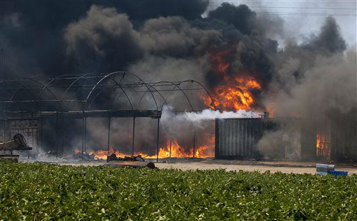 "<div class=""meta ""><span class=""caption-text "">Flames and smoke rise from chemical storage tanks near a strawberry farm in Camarillo, Calif., Thursday, May 2, 2013. (AP Photo/Ringo H.W. Chiu) (AP Photo/ Ringo H.W. Chiu)</span></div>"