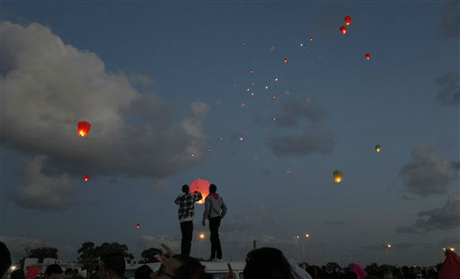 Libyans release lanterns into the air,  at Nasr Square, during the second anniversary of the uprising that toppled longtime dictator Moammar Gadhafi in Benghazi, Libya, Sunday, Feb, 17, 2013.  &#40;AP Photo&#47;Mohammad Hannon&#41; <span class=meta>(AP Photo&#47; Mohammad Hannon)</span>