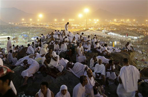 Muslim pilgrims pray on a rocky hill called the Mountain of Mercy, on the Plain of Arafat near the holy city of Mecca, Saudi Arabia, in the early hours of Thursday, Oct. 25, 2012. Saudi authorities say around 3.4 million pilgrims ? some 1.7 million of them from abroad ? have arrived in the holy cities of Mecca and Medina for this year&#39;s pilgrimage. &#40;AP Photo&#47;Hassan Ammar&#41; <span class=meta>(AP Photo&#47; Hassan Ammar)</span>