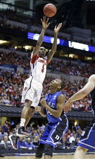 Louisville guard Kevin Ware &#40;5&#41; shoots over Duke guard Rasheed Sulaimon during the first half of the Midwest Regional final in the NCAA college basketball tournament, Sunday, March 31, 2013, in Indianapolis. &#40;AP Photo&#47;Michael Conroy&#41; <span class=meta>(AP Photo&#47; Michael Conroy)</span>