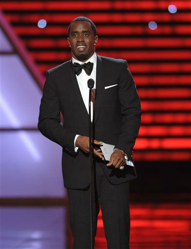 "<div class=""meta image-caption""><div class=""origin-logo origin-image ""><span></span></div><span class=""caption-text"">Sean ""Diddy"" Combs speaks on stage at the ESPY Awards on Wednesday, July 17, 2013, at the Nokia Theater in Los Angeles. (Photo by John Shearer/Invision/AP) (Photo/John Shearer)</span></div>"