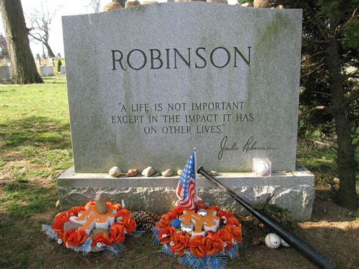 This April 9, 2013 photo shows Jackie Robinson?s gravesite, where fans still leave tributes to the man who integrated Major League Baseball when he joined the Brooklyn Dodgers in 1947. A new movie, ?42,? about Robinson?s life is bringing his inspiring story to a new generation. Fans young and old can find a number of places in Brooklyn connected to Robinson, including his burial site in Cypress Hills Cemetery, which straddles the border of Brooklyn and Queens and is reachable via the Jackie Robinson Parkway. &#40;AP Photo&#47;Beth J. Harpaz&#41; <span class=meta>(AP Photo&#47; Beth J. Harpaz)</span>
