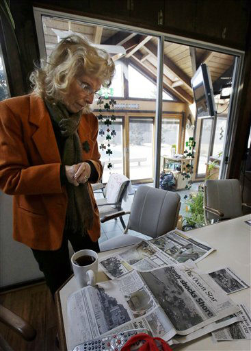 Joyce Popaca looks at news clippings as she stands in her home in Mantoloking, N.J., Friday, Feb. 22, 2013. New Jersey has reached another milestone in its recovery 116 days after Superstorm Sandy struck. One of the hardest-hit Jersey shore communities, Mantoloking, will allow its residents to begin moving back home Friday. It is the last shore town to do so. &#40;AP Photo&#47;Mel Evans&#41; <span class=meta>(AP Photo&#47; Mel Evans)</span>