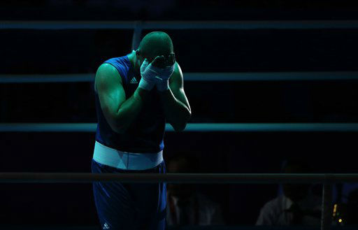 Siarhei Karneyeu of Belarus, reacts after his fight against Teymur Mammadov of Azerbaijan, during a heavyweight 91-kg quarterfinal boxing match at the 2012 Summer Olympics, Sunday, Aug. 5, 2012, in London.  &#40;AP Photo&#47;Ivan Sekretarev&#41; <span class=meta>(AP Photo&#47; Ivan Sekretarev)</span>