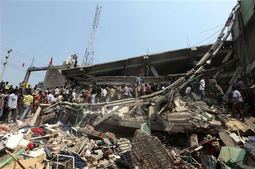 "<div class=""meta ""><span class=""caption-text "">Rescue workers look for survivors after an eight-story building housing several garment factories collapsed in Savar, near Dhaka, Bangladesh, Wednesday, April 24, 2013. Dozens were killed and many more are feared trapped in the rubble. (AP Photo/ A.M. Ahad) (AP Photo/ A.M. Ahad)</span></div>"
