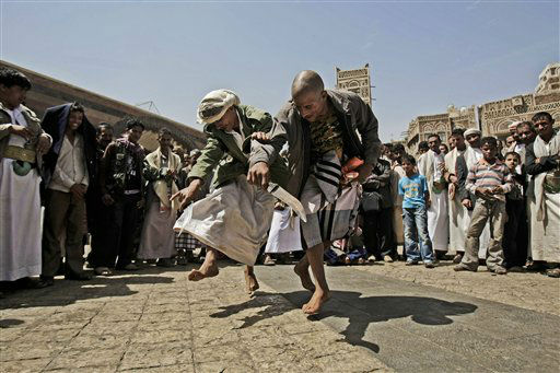 "<div class=""meta ""><span class=""caption-text "">Yemeni men perform a traditional dance known as bar'a in the old city of Sanaa, Yemen, Sunday, March 10, 2013. Bar'a is an ancient Yemeni dance which was a sign of tribal identity and power. (AP Photo/Hani Mohammed) (AP Photo/ Hani Mohammed)</span></div>"