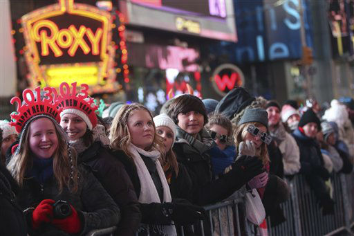 Vicky Tepper, left, and Nina Lober of Germany, join smile as they watch the warm up performance during Times Square New Year&#39;s celebration Monday, Dec. 31, 2012 in New York.  &#40;AP Photo&#47;Mary Altaffer&#41; <span class=meta>(AP Photo&#47; Mary Altaffer)</span>