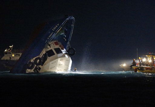 "<div class=""meta image-caption""><div class=""origin-logo origin-image ""><span></span></div><span class=""caption-text"">Rescuers check on a half submerged boat after it collided Monday night near Lamma Island, off the southwestern coast of Hong Kong Island Tuesday, Oct. 2, 2012. Authorities in Hong Kong have rescued 101 people after a ferry collided with a tugboat and sank. A local broadcaster says eight people died. (AP Photo/Kin Cheung) (AP Photo/ Kin Cheung)</span></div>"