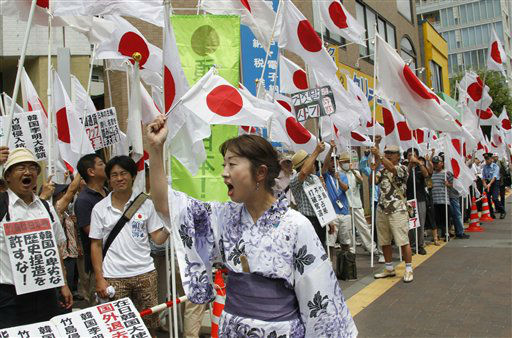 Protesters shout slogans during a rally against South Korea in Tokyo, Thursday, Aug. 16, 2012. A group of South Korean protesters, swimming across the sea in a relay, reached contested islands in the Sea of Japan, called Takeshima in Japanese and Dokdo in Korean on Wednesday in a demonstration aimed at belittling Japan&#39;s claims to that territory. &#40;AP Photo&#47;Koji Sasahara&#41; <span class=meta>(AP Photo&#47; Koji Sasahara)</span>